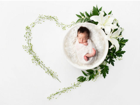 DESCRIPTION: Relax and have fun with your new family while we create your precious memories that you will treasure for a lifetime. They will never be this small again. We love to watch your family grow and also offer family portraits.